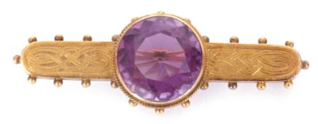 Antique Etruscan amethyst brooch centring a round faceted amethyst, 14mm diam, in a cut down