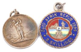 """Mixed Lot: enamel coin pendant, """"Zuid Afrik Repub 1896"""" 2 shillings, together with the Artisan"""