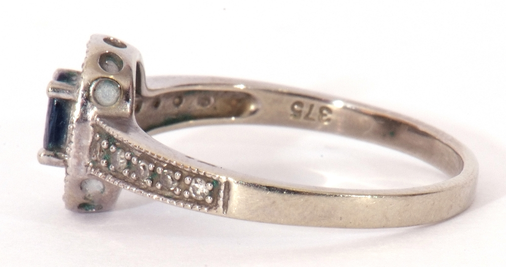 Modern 375 stamped synthetic sapphire and diamond ring, the oval shaped centre stone raised above - Image 3 of 10