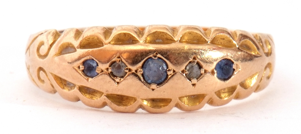 Edwardian 15ct gold, sapphire and diamond ring, alternate set with small graduated sapphires and two