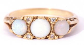 18ct gold opal and diamond ring featuring three graduated round cut cabochon opals, with four
