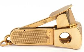 Late 20th century hallmarked 9ct gold encased cigar cutter with engine turned grips and ringlet