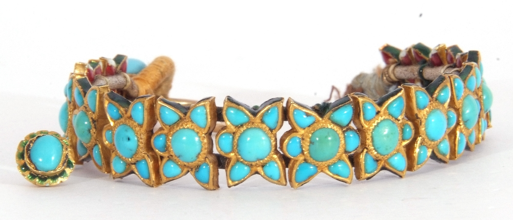Probably Indian fabric backed yellow metal and turquoise star panelled bracelet, 15cm long (a/f)