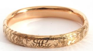 Gold plated hinged bracelet, part chased and engraved, inside diam 5.5 x 6cm