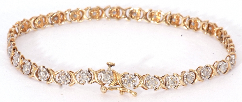 Diamond set line bracelet featuring 30 small diamonds, each in an illusion setting, joined by X-