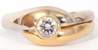 18ct gold brilliant cut solitaire diamond ring, the bezel set diamond raised above two-tone cross