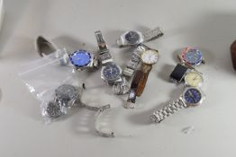 PLASTIC BOX CONTAINING GENTS WRIST WATCHES