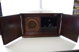 WOODEN CABINET CONTAINING A VINTAGE AMPLIFIER
