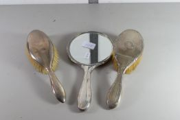 BIRMINGHAM SILVER MIRROR, TOGETHER WITH A BIRMINGHAM SILVER BACKED BRUSH AND FURTHER BRUSH