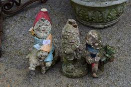 THREE COMPOSITE GARDEN GNOMES