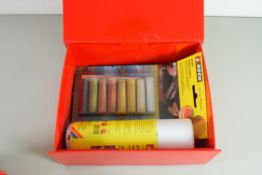 Box containing Noch detail effect paint, spray adhesive and three brushes