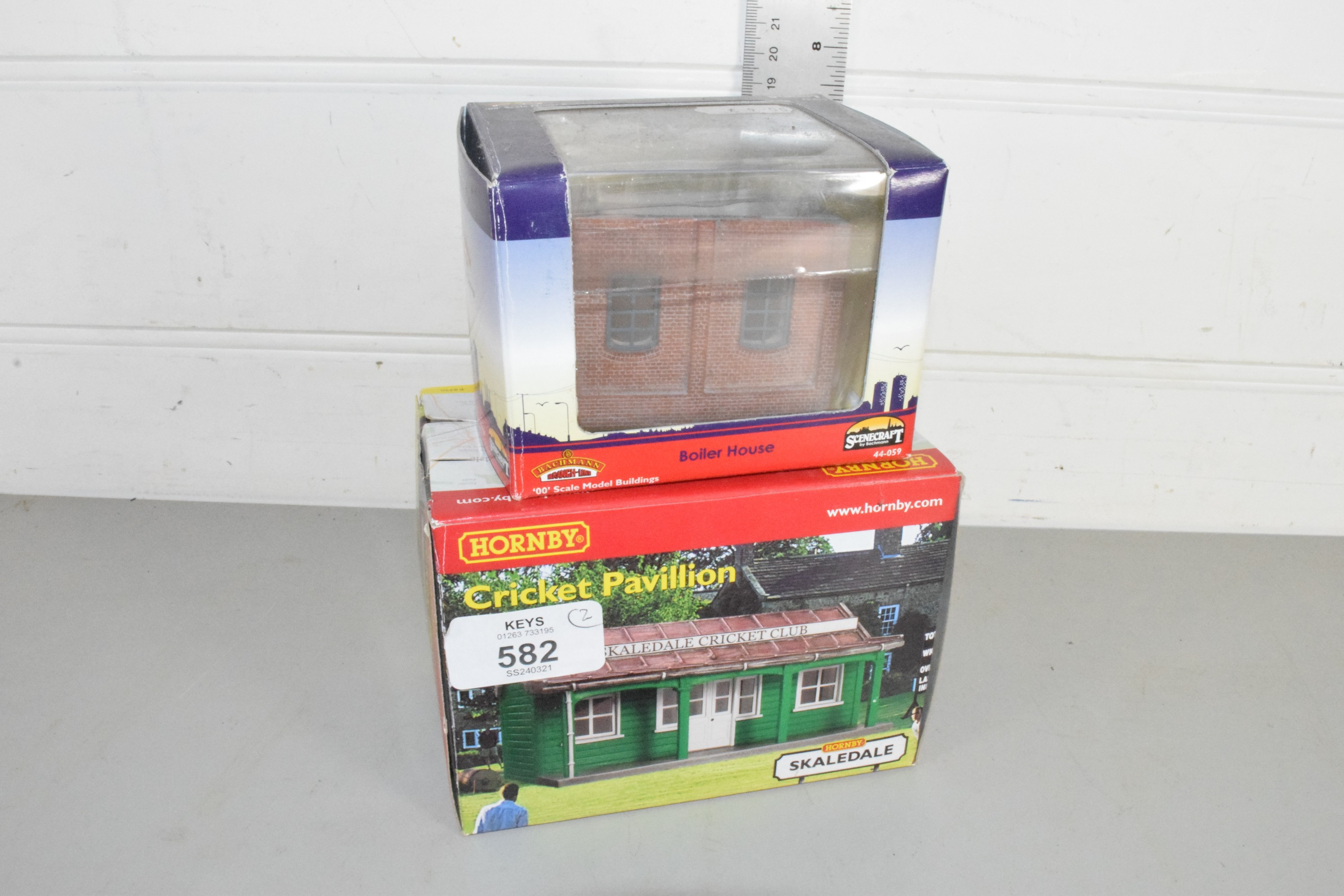 Boxed Hornby cricket pavilion no R8990, together with a Bachmann boiler house no 44-059