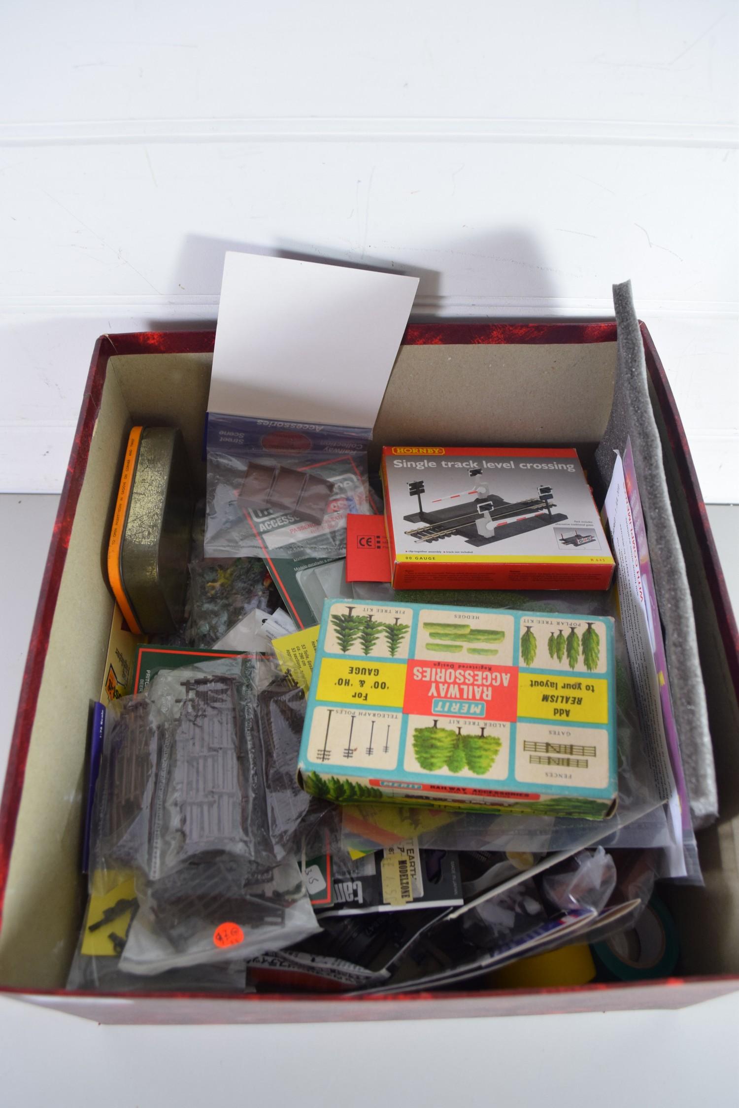 Box containing various model railway scenery accessories, figures etc