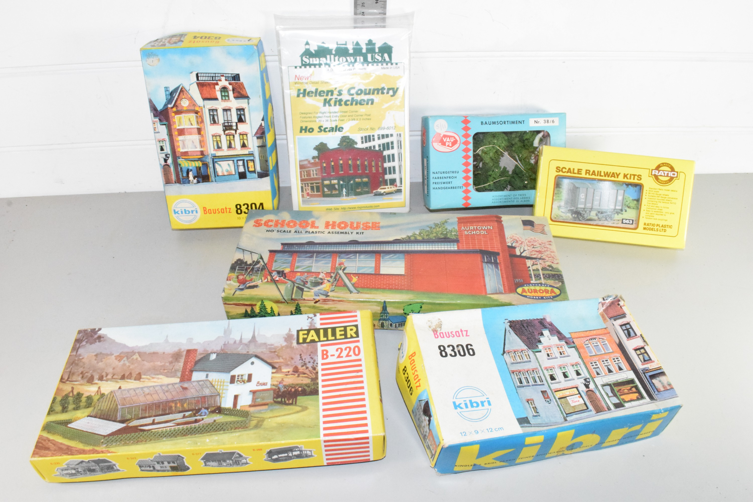 Small box containing model buildings, dioramas, some by Kibri