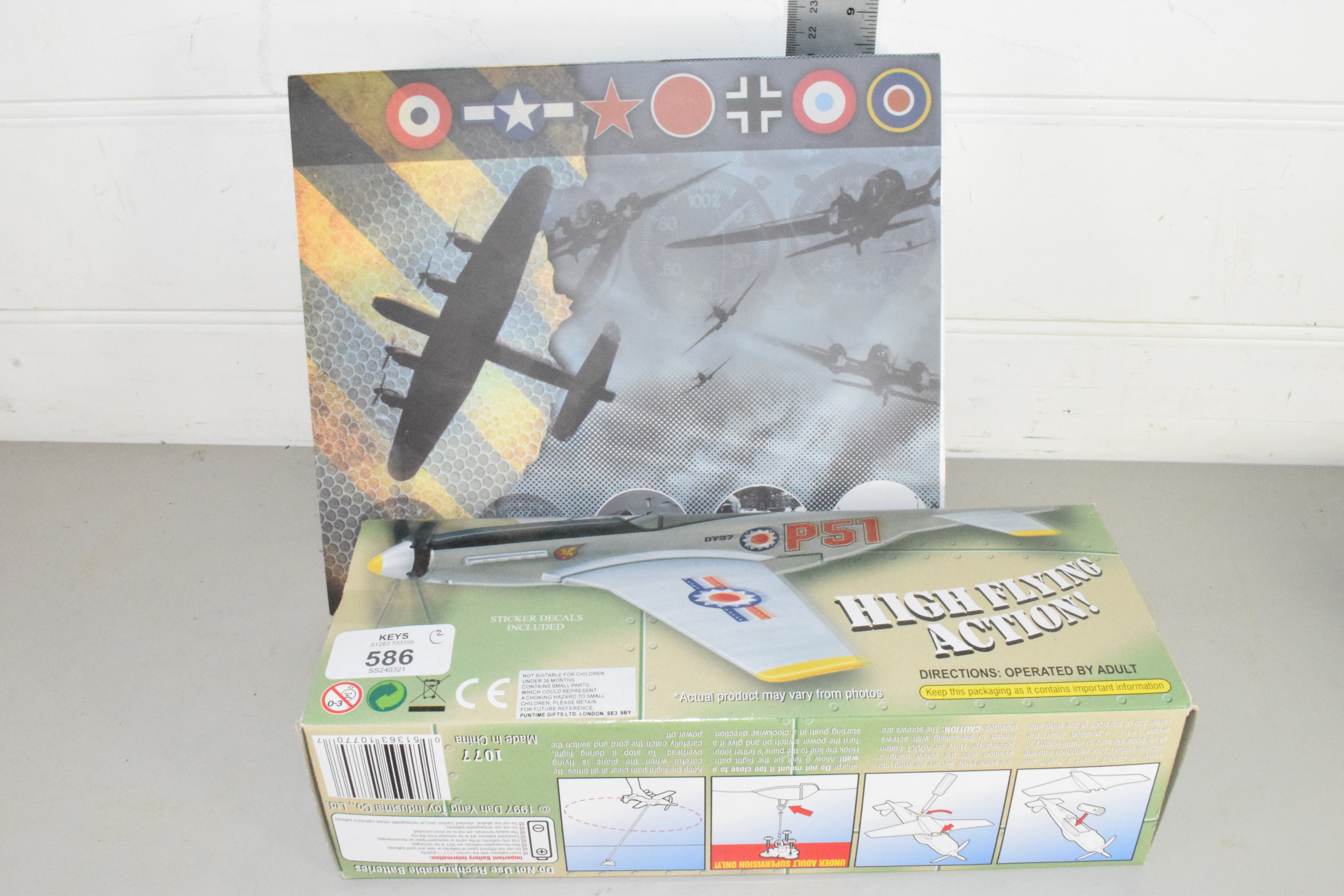 Boxed Skyfighter aircraft together with a boxed Atlas Editions WWII aircraft