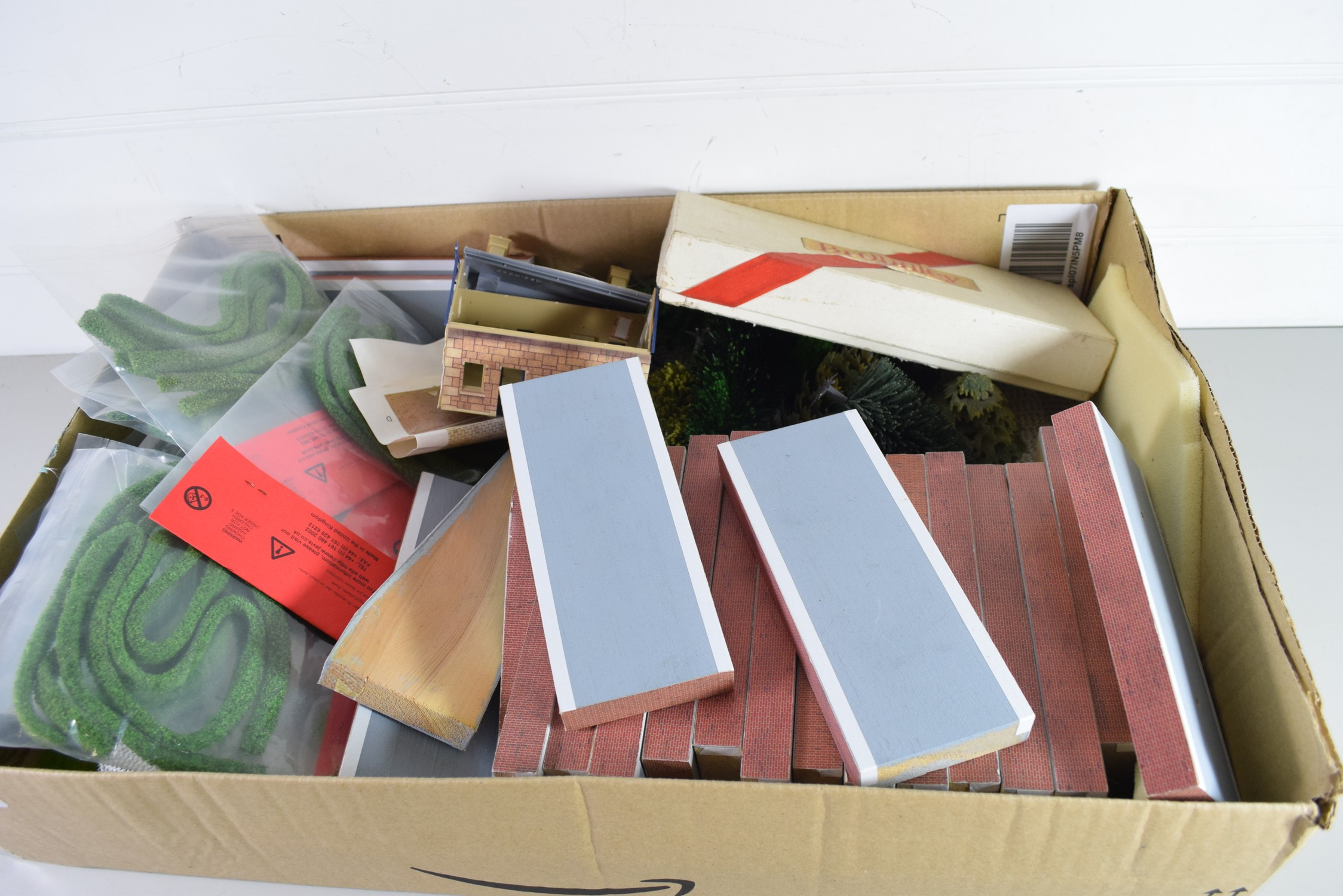 Box containing railway accessories, mainly scenery, wooden platforms etc