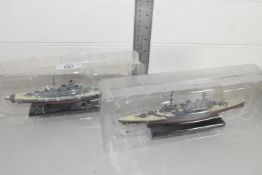 Two mounted ship models, one of The Bismarck, one HMS Hood