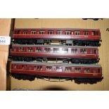 Group of three unboxed 00 gauge Bachmann coaches in red livery