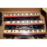 Group of three unboxed 00 gauge Hornby coaches in red and cream livery