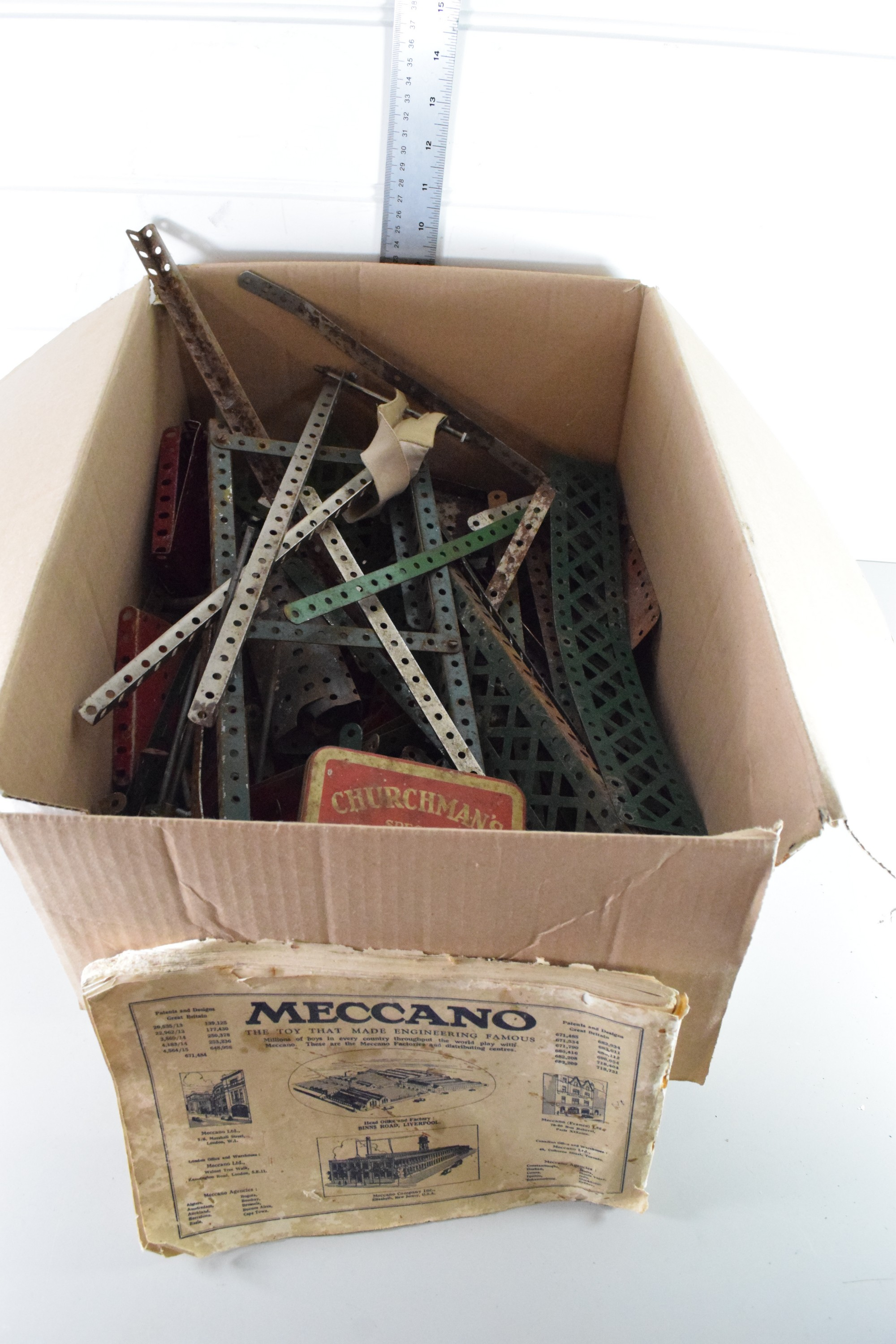 Box containing vintage Meccano and instruction manual
