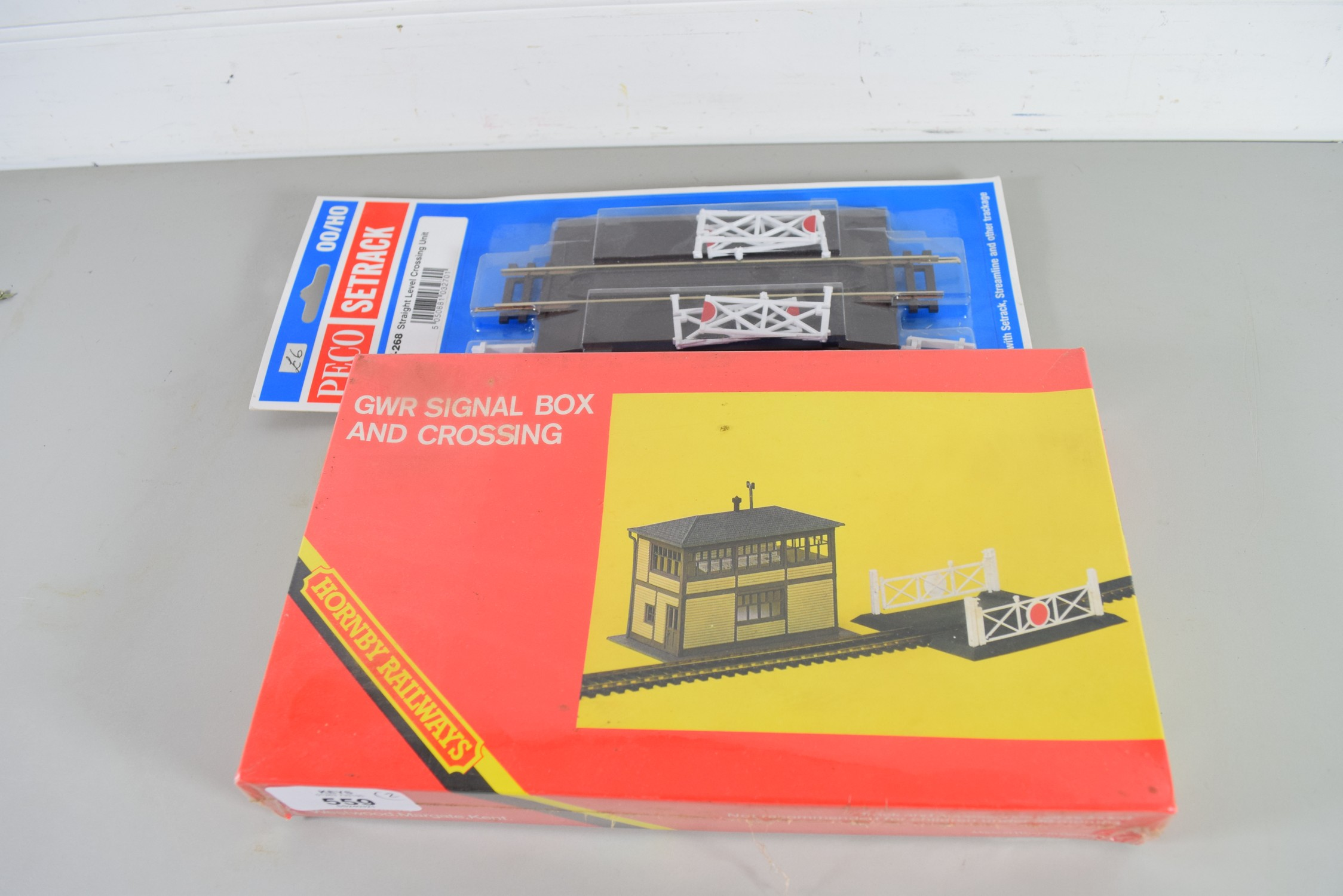 Boxed Hornby 00 gauge R186 GWR signal box and crossing together with a Peco set rack ST-268 straight