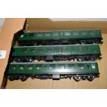 Group of three unboxed 00 gauge Bachmann coaches in green livery