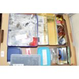 Tray containing model railway diorama items including packaged insulation sleeves, wiring,