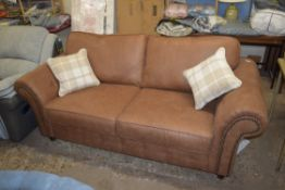 STAGGS THREE-SEATER SOFA, BROWN FAUX LEATHER, WITH TWO CUSHIONS