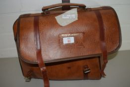 LARGE LEATHER BAG CONTAINING BOWLS