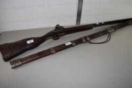 MIDDLE EASTERN STYLE DOUBLE BARREL FLINTLOCK SHOTGUN AND A SWORD