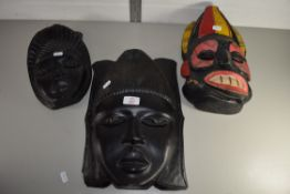 THREE CARVED TRIBAL ART HEADS