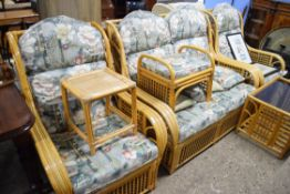 CANE CONSERVATORY SUITE COMPRISING TWO-SEATER SOFA, TWO CHAIRS, STOOL, COFFEE TABLE AND OCCASIONAL