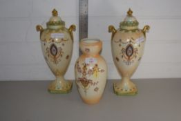 VASES BY CROWN DEVON, A PAIR WITH COVERS AND A FURTHER VASE (3)