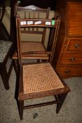 TWO VARIOUS CANE SEATED DINING CHAIRS