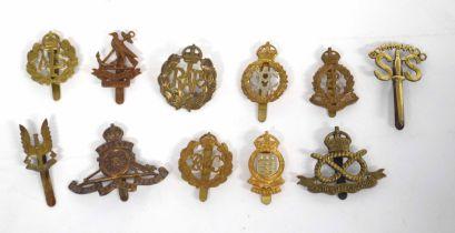 Quantity of eleven 20th century British military cap badges to include SAS, No 2 Commando, RAC, ATS,
