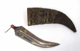 Jambiya dagger lacking handle, together with brass ornate curved sheaf (a/f)