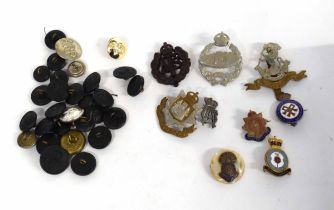 Small quantity of 20th century British cap badges, buttons and brooches to include 23 black Bakelite