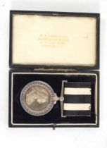 Cased service medal, Order of St John, by H.T.Lamb & Co, impressed to 6125 A/SIS.M.J. Tonge,