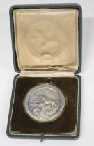 """Cased Third Reich 1938 dated German dog hunting medal with scenes of stag hounds inscribed """""""