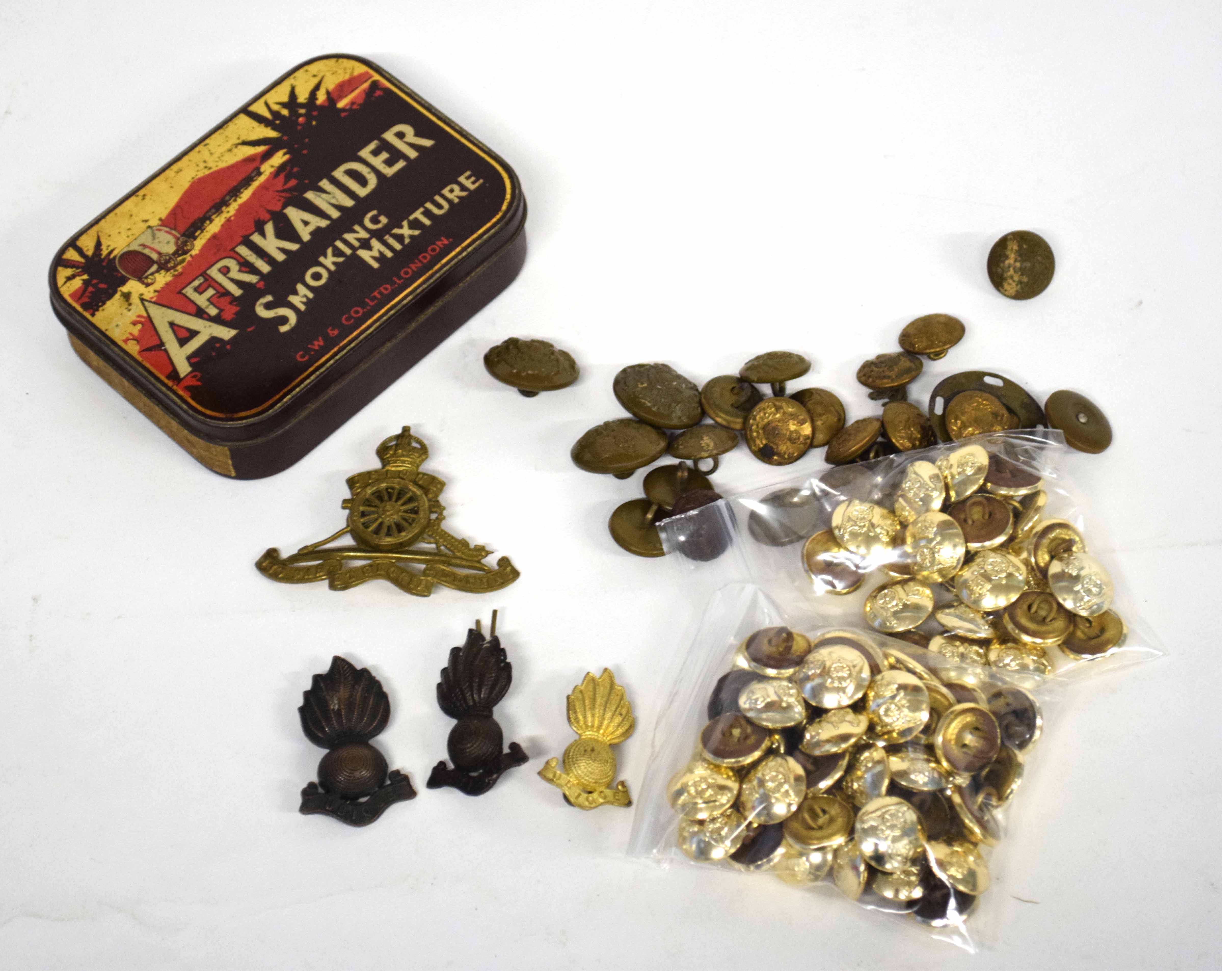 Quantity of Royal Artillery cap badges, collar dogs and buttons and a quantity of General Service