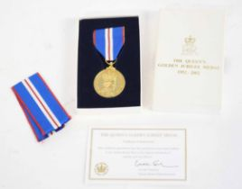 Cased Queen Elizabeth II Golden Jubilee medal, 1952-2002, with extra ribbon and certificate of