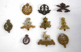 Quantity of ten British military cap badges to include Royal Machine Gun Corps, Royal