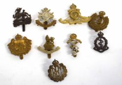 Quantity of nine 20th century British military cap badges to include Royal Flying Corps, Royal