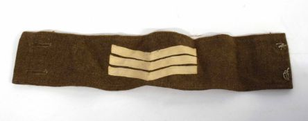 20th century British Army Sgt insignia armband upon battledress serge material (lacking buttons)