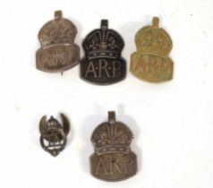 Five 20th century badges to include three silver ARP badges, one further ARP badge, silver plated