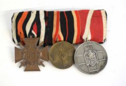 Group of First/Second World War Third Reich German medals of three comprising Hindenburg Cross/