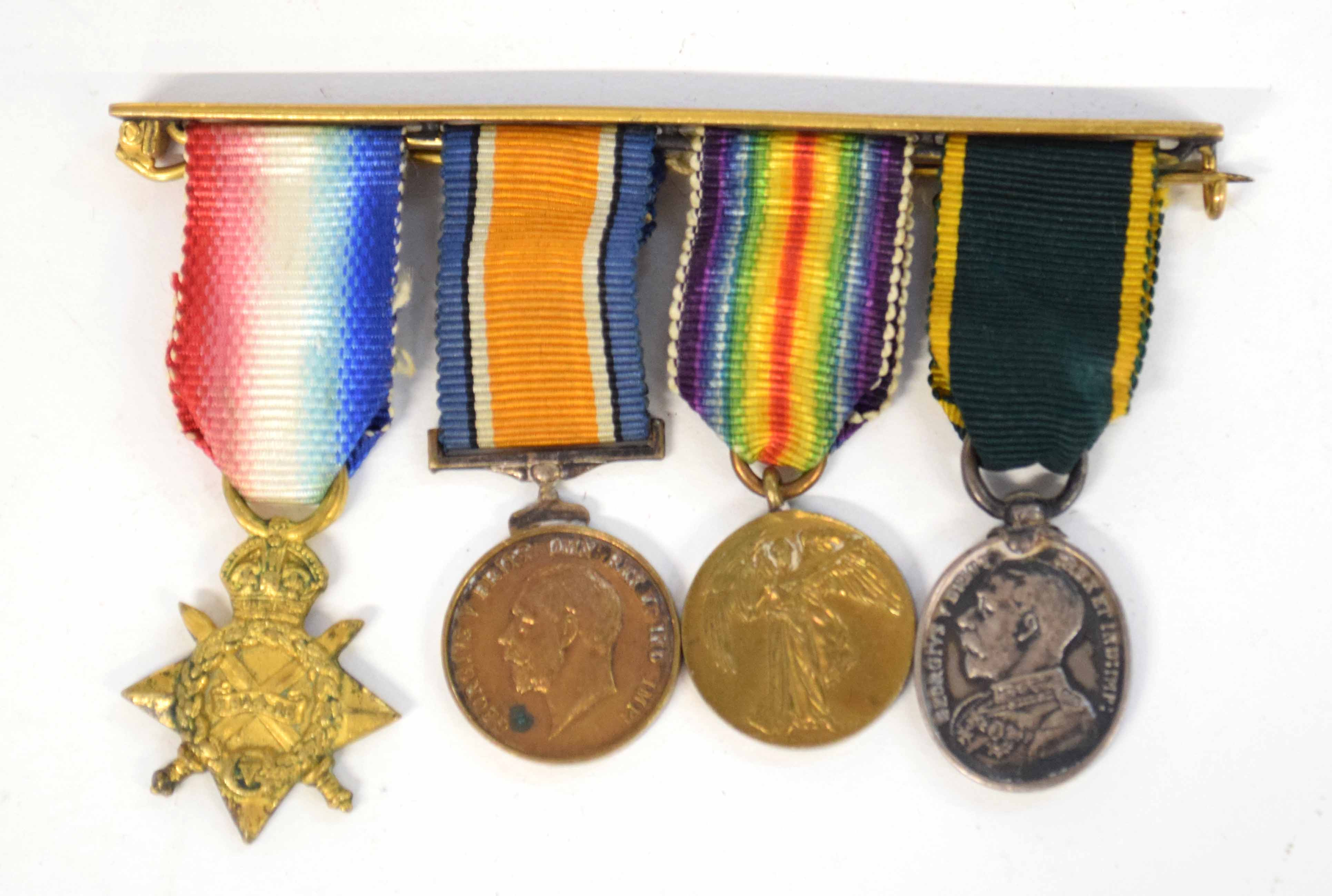 Set of four WWI medal miniatures to include 1914-15 Star, 14-18 War medal, 1914-19 Victory medal and