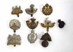 Quantity of ten military cap badges to include a Victorian King's Own Yorkshire Light Infantry bi-