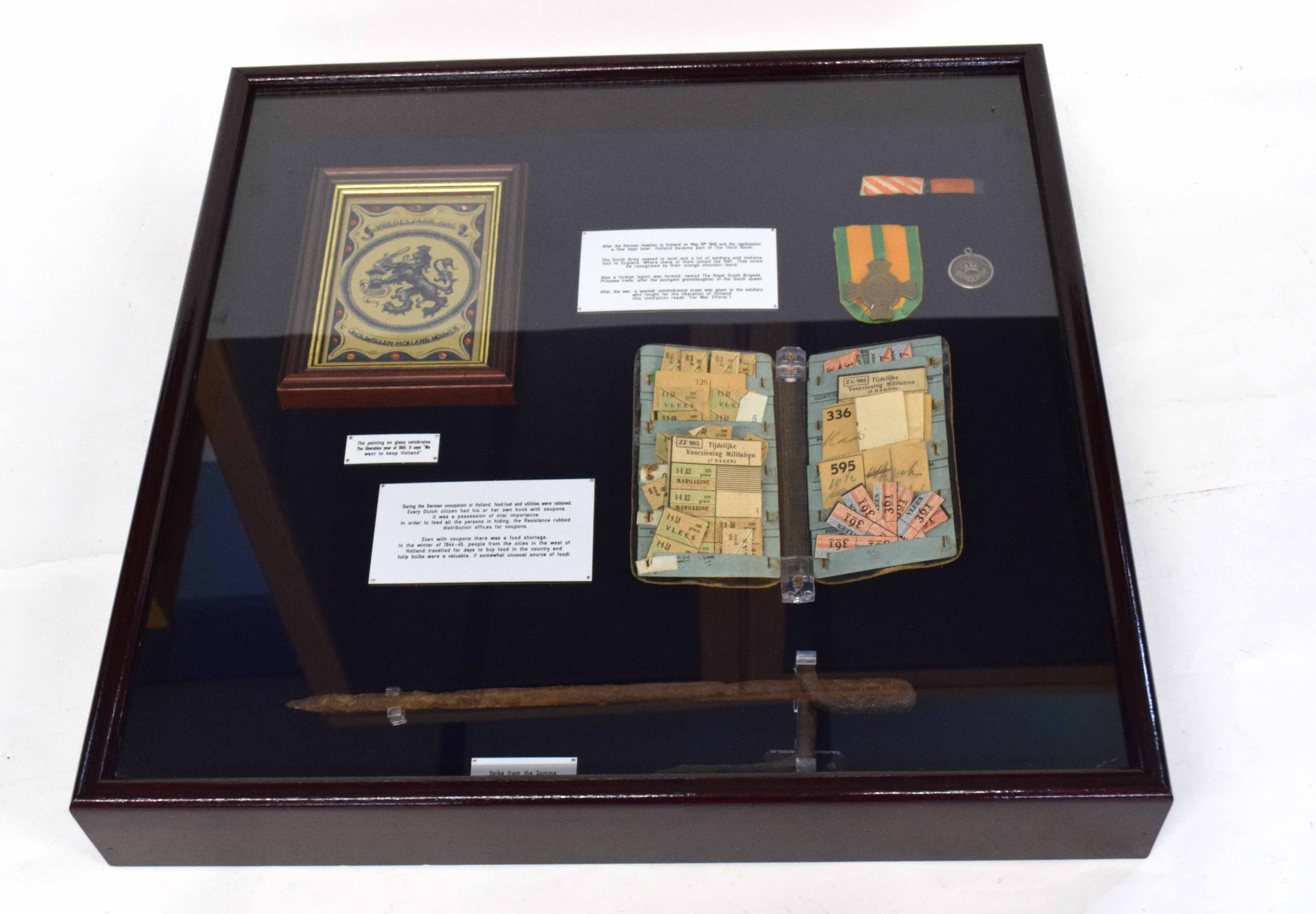 WWII display case with items from German occupied Holland to include civilian ration coupon