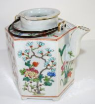 Oriental porcelain kettle decorated in polychrome with flowers, 19th century, 16cm high